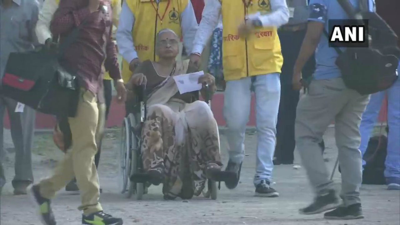 A differently-abled voter being helped by polling personnel in Jhansi, Uttar Pradesh. (Image: ANI)