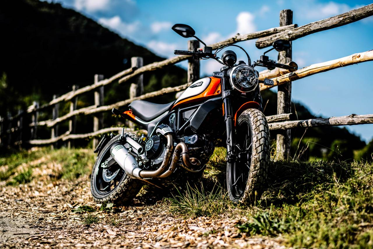 """The Ducati Scrambler Icon is now available in the new """"Atomic Tangerine"""" paint scheme with black frame, black seat and grey rims and in the classic """"62 yellow"""" colour, again with black frame, black seat and grey rims (Image: Ducati)"""