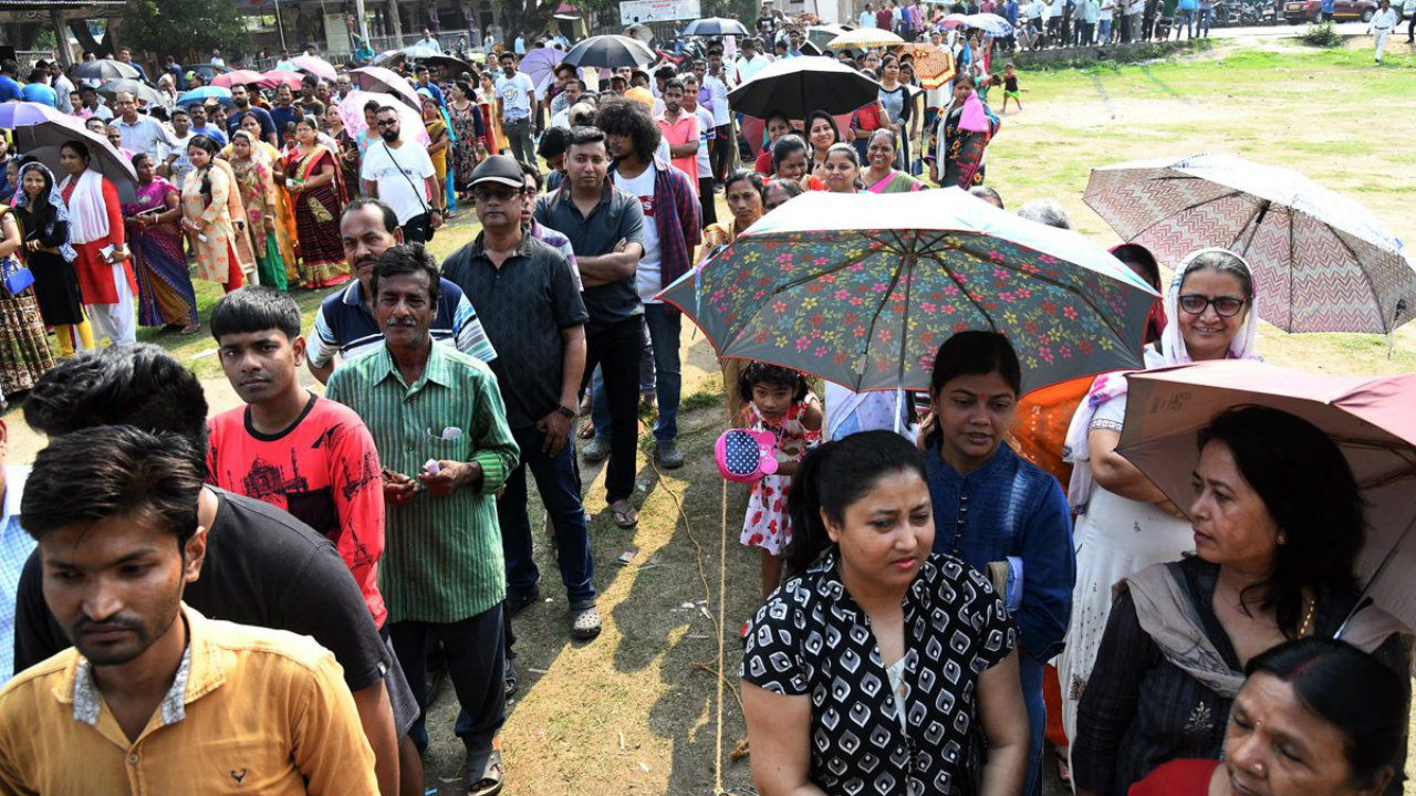 Voters wait for their turn to cast vote in Guwahati, Assam. (Image: Twitter/PIB India)