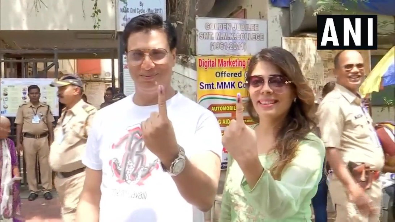 Director Madhur Bhandarkar and his wife pose for photographs after casting vote during the fourth phase of Lok Sabha polls in Mumbai. (Image: ANI)