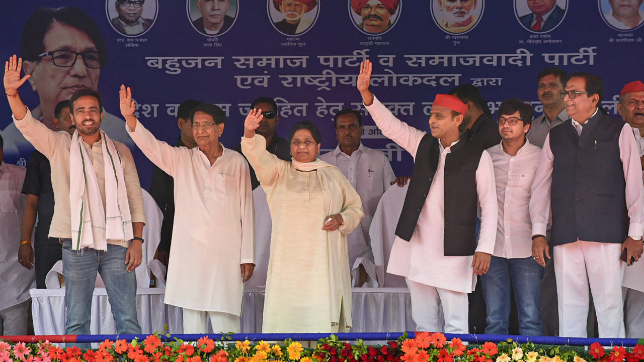 Samajwadi Party President Akhilesh Yadav, BSP chief Mayawati and RLD chief Ajit Singh along with other leaders wave at the supporters during their joint election campaign rally at Deoband in Saharanpur. (Image: PTI)