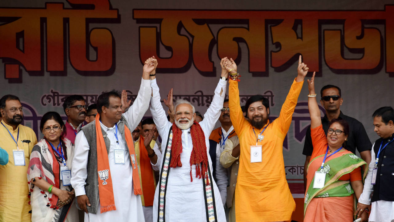 PM Narendra Modi at an election campaign rally in support of the BJP candidates, ahead of the Lok Sabha elections at Rash Mela Ground in Cooch Behar district of West Bengal. (Image: PTI)