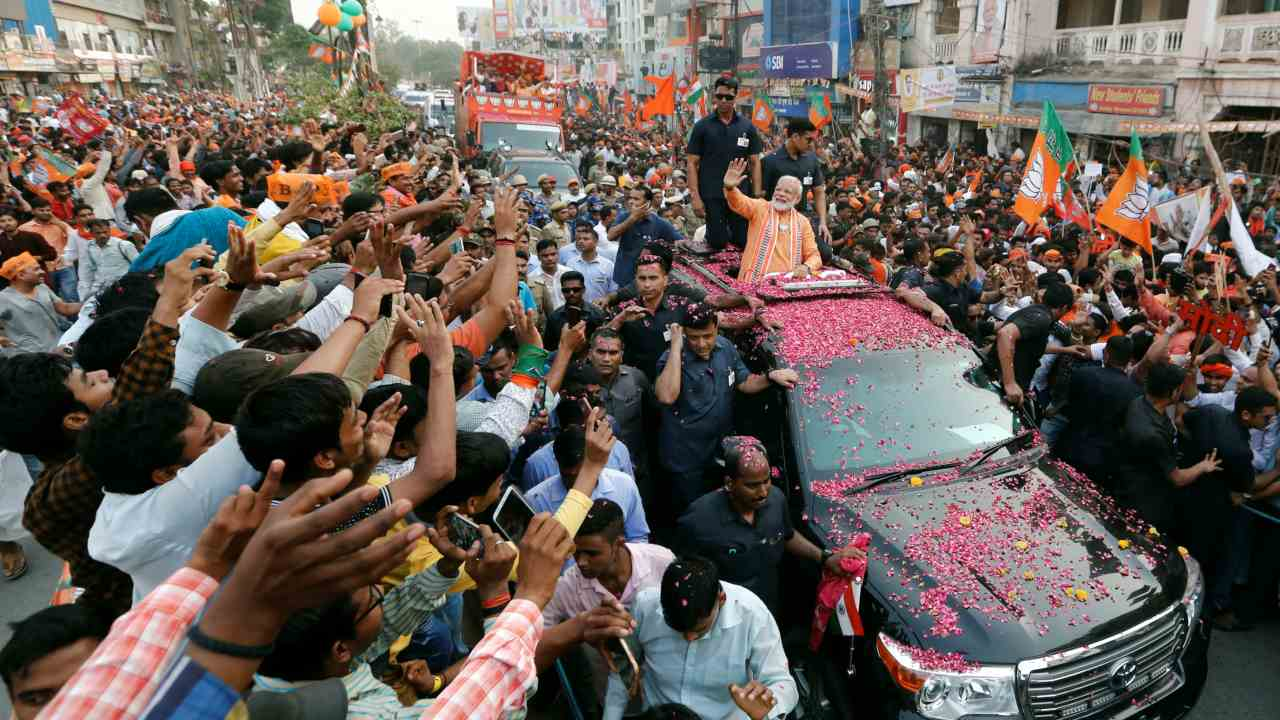 India's Prime Minister Narendra Modi waves towards his supporters during a roadshow in Varanasi, India. (Image: Reuters)