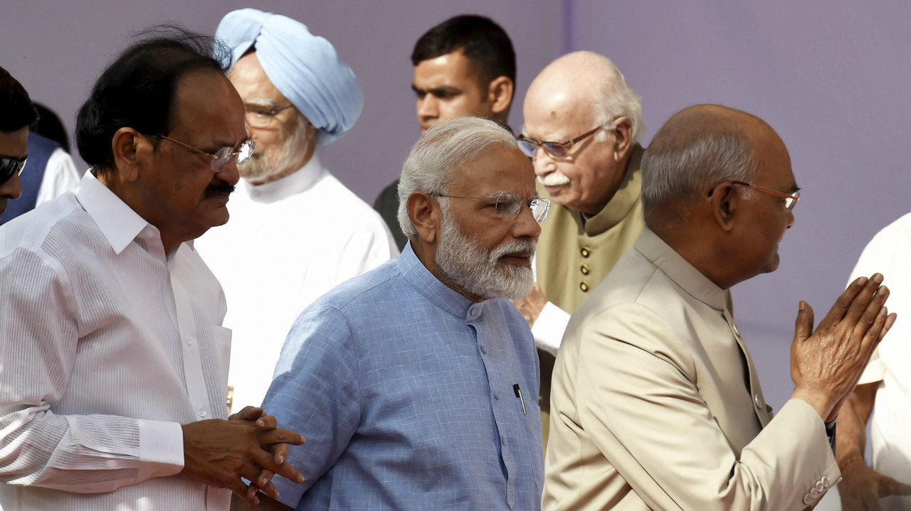 President Ram Nath Kovind (right), Vice President M Venkaiah Naidu (left), Prime Minister Narendra Modi (center) and other dignitaries arrive to pay tribute to Babasaheb BR Ambedkar on the occasion of his 128th birth anniversary, at Parliament House in New Delhi. (Image: PTI)