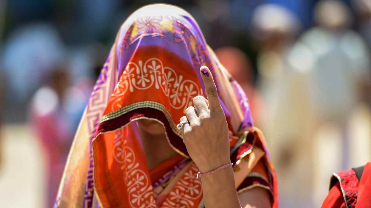 A woman after voting in the second phase of the Lok Sabha elections. (Image: PTI)