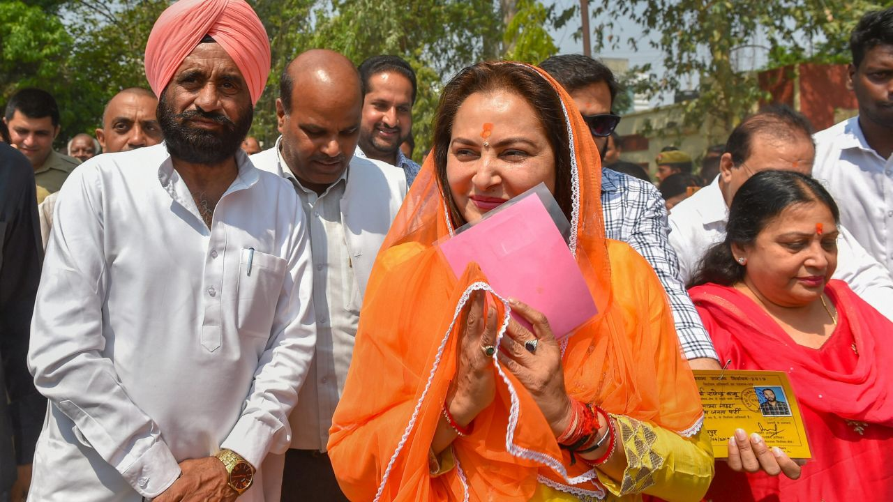 BJP candidate from Rampur, Jaya Prada, arrives to cast her vote during the third phase of the 2019 Lok Sabha elections, at a polling station in Rampur, Uttar Pradesh. (Image: PTI)