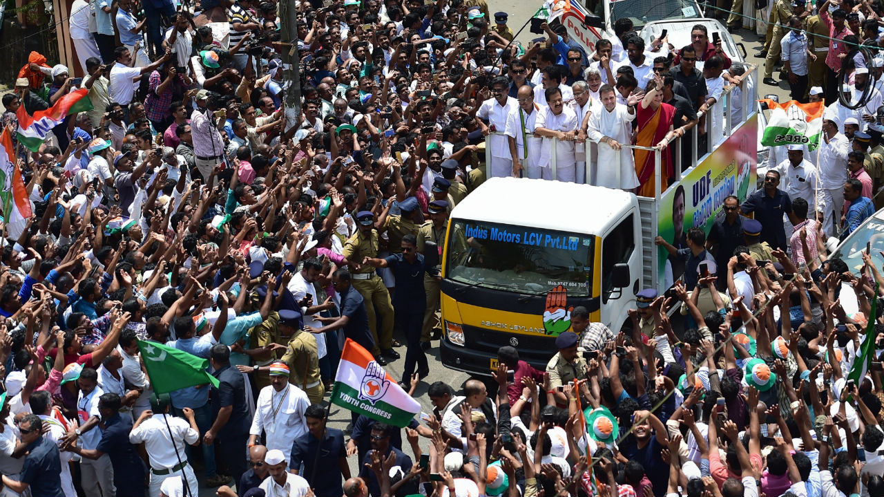 Congress President Rahul Gandhi with party General Secretary Priyanka Gandhi Vadra and other leaders wave at party supporters during a roadshow after filing his nomination papers for Lok Sabha elections, in Wayanad, Kerala. (Image: PTI)
