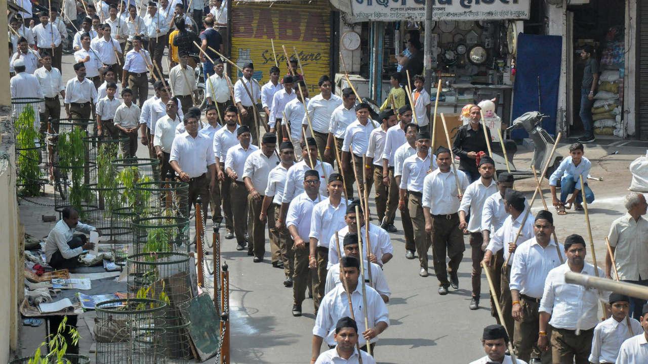 RSS volunteers take part in a 'path sanchalan' on the occasion of Hindu New Year day, in Moradabad. (Image: PTI)