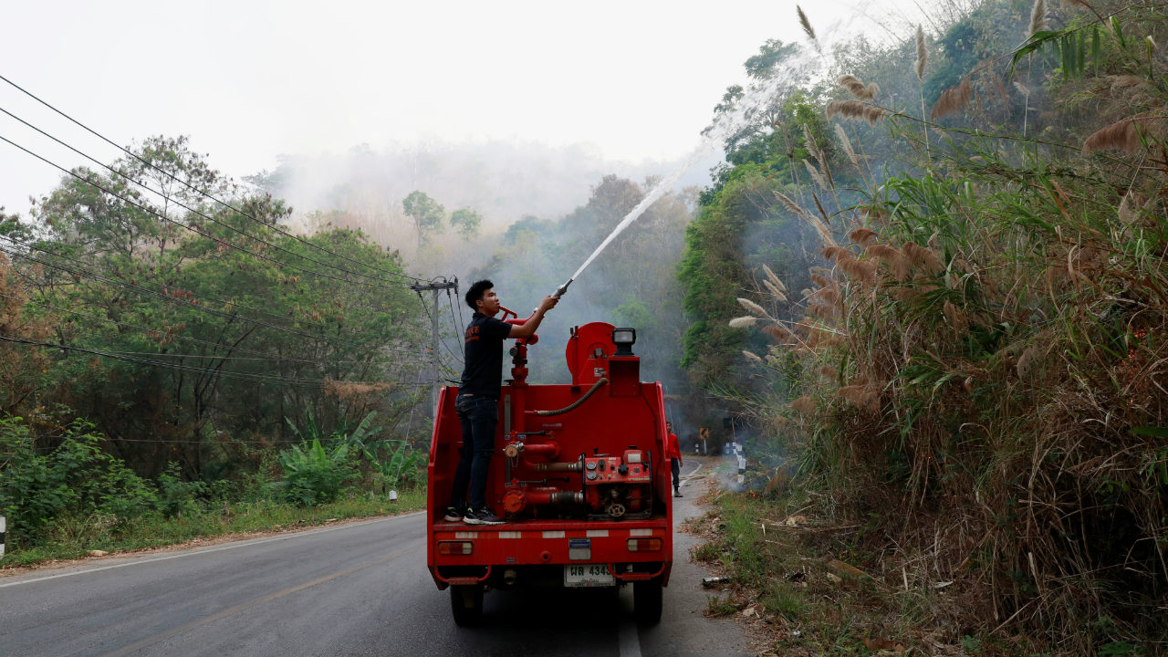 A firefighter works to extinguish the forest fire in Samoeng district, Thailand (Image: Reuters)