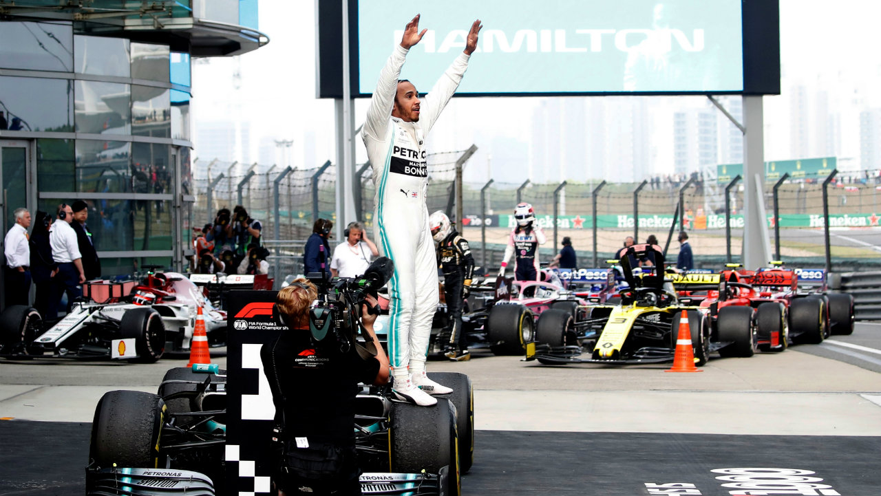 Mercedes' Lewis Hamilton celebrates winning the Formula 1 (F1) Chinese Grand Prix at the Shanghai International Circuit, Shanghai, China. Hamilton and Bottas finished number one and two, respectively, in what was the 1,000th F1 World Championship race. (Image: Reuters)