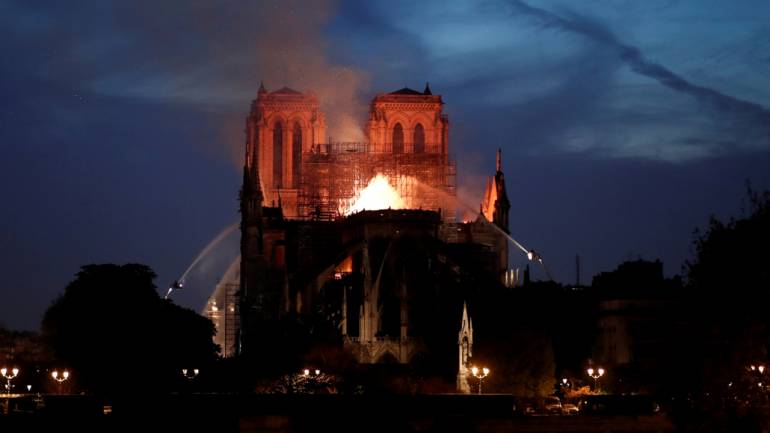 Fire fighters douse flames of the burning Notre Dame Cathedral in Paris, France April 15, 2019. Image: REUTERS