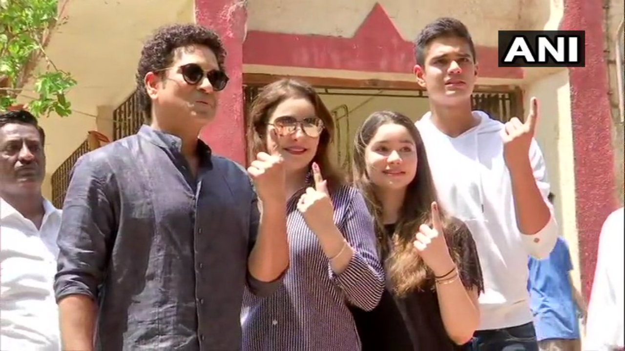 Former cricketer Sachin Tendulkar poses with his family after casting vote in Mumbai. (Image: ANI)