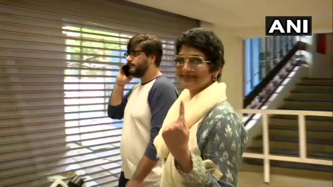 Actress Sonali Bendre and her film maker husband Goldie Behl after casting their votes in Mumbai. (Image: ANI)