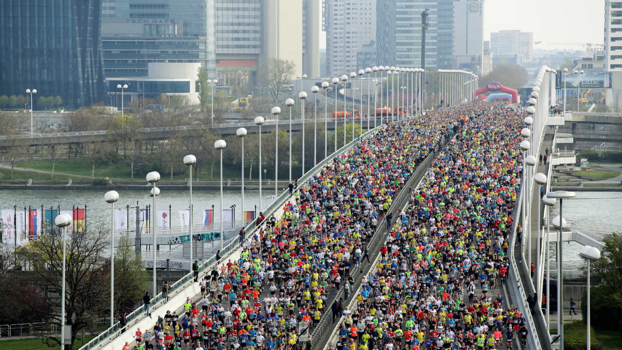 Runners cross the river Danube over the Reichsbruecke bridge after the start of the Vienna City Marathon in Vienna, Austria. (Image: Reuters)