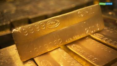 Gold rebounds from near four-month low, oil rally lends support