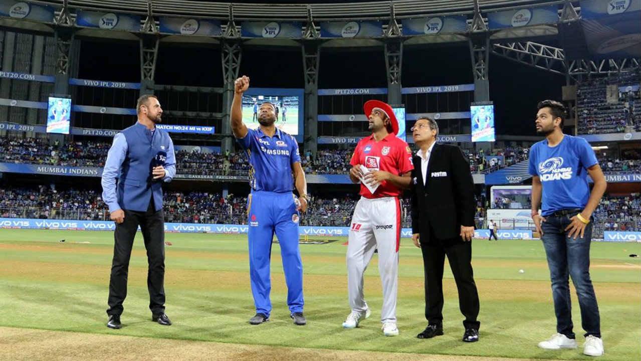 Mumbai Indians (MI) welcomed Kings XI Punjab (KXIP) to the Wankhede Stadium, Mumbai for match 24 of the 2019 Indian Premier League (IPL). Kieron Pollard stepped in to captain Mumbai in the absence of Rohit Sharma who injured himself in training. He won the toss and opted to bowl. Mumbai made just one change with Siddhesh Lad making his IPL debut replacing Rohit. KXIP made two changes with Karun Nair stepping in for the injured Mayank Agarwal and Hardus Viljoen replacing Mujeeb Ur Rahman. (Image: BCCI, iplt20.com)