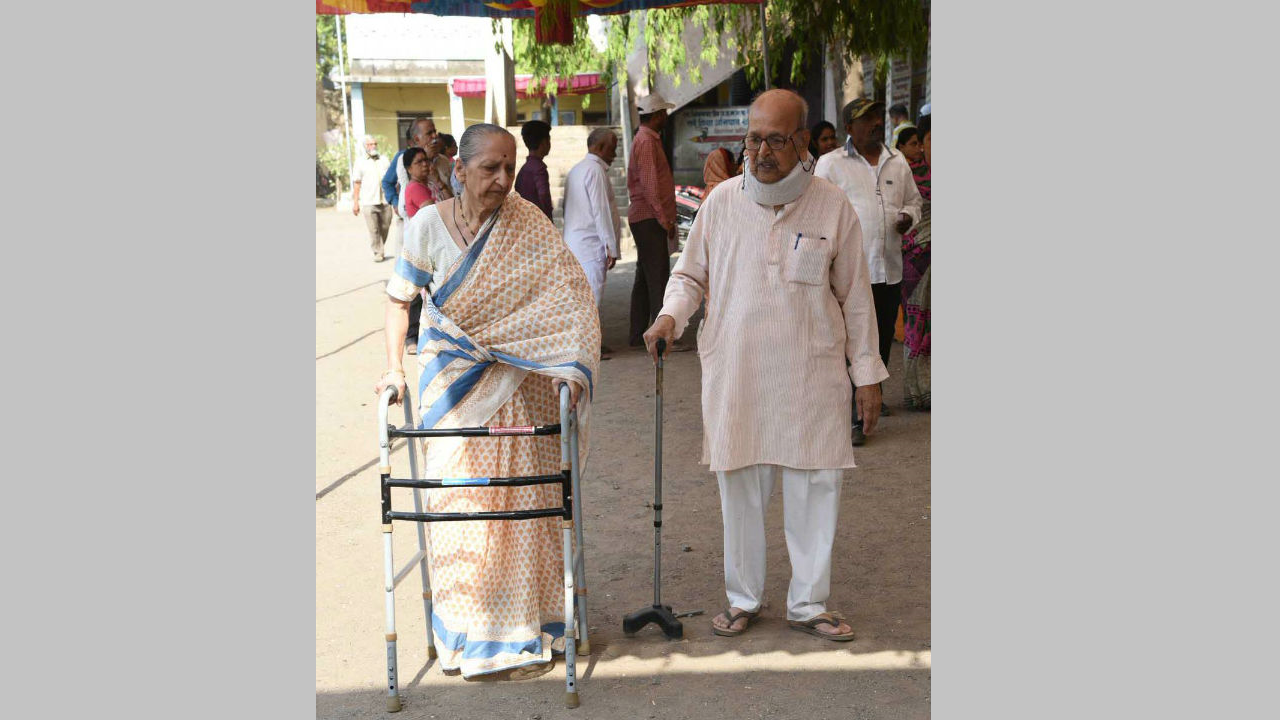 The senior citizens arrive at a polling booth to cast their vote for the Phase 3 of Lok Sabha elections 2019, at Jalgoan in Maharashtra. (Image: Twitter/@PIB_India)