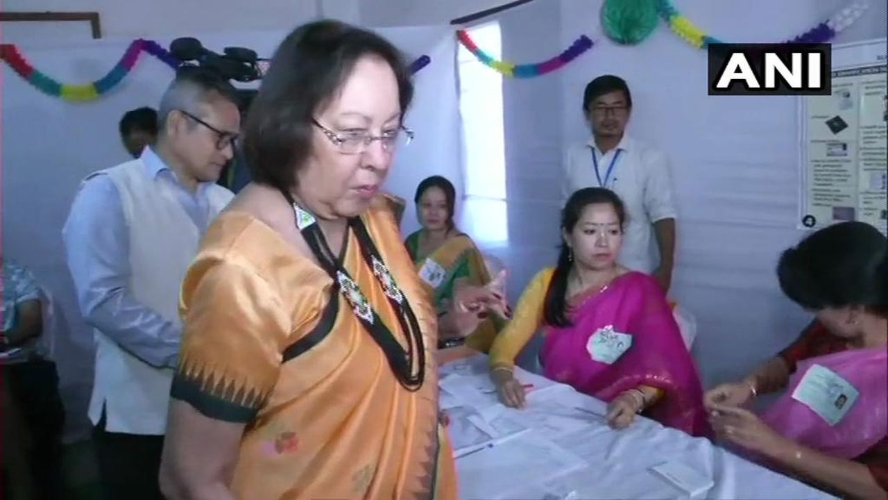 Governor of Manipur Najma Heptulla cast her vote at a polling station in Imphal. (Image: Twitter/@ANI)