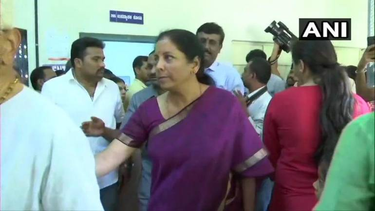 Defence Minister Nirmala Sitharaman casts her vote at polling booth 54 in Jayanagar of Bangalore South Parliamentary constituency, Karnataka. (Image: Twitter/@ANI)