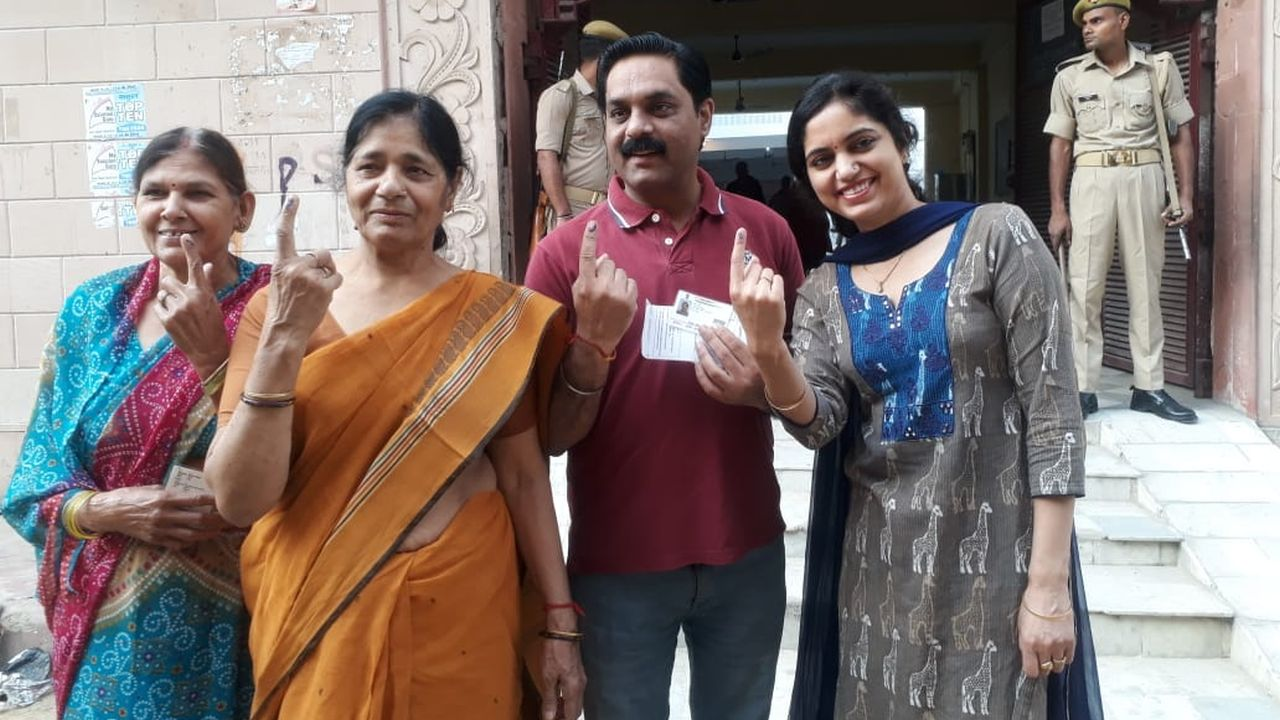 Voters show inked fingers after casting their votes in Muzaffarnagar, Uttar Pradesh. Polling is underway for eight Lok Sabha seats in the state since 7 am. (Image: Twitter/@SpokespersonECI)