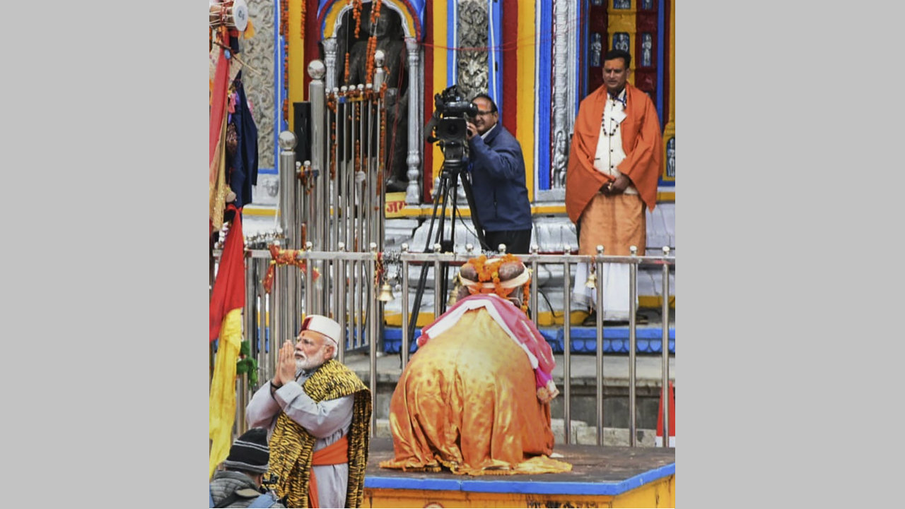 Dressed in a traditional pahari outfit, PM Modi offered prayers at the temple and undertook circumambulation of the shrine. (Image: PTI)