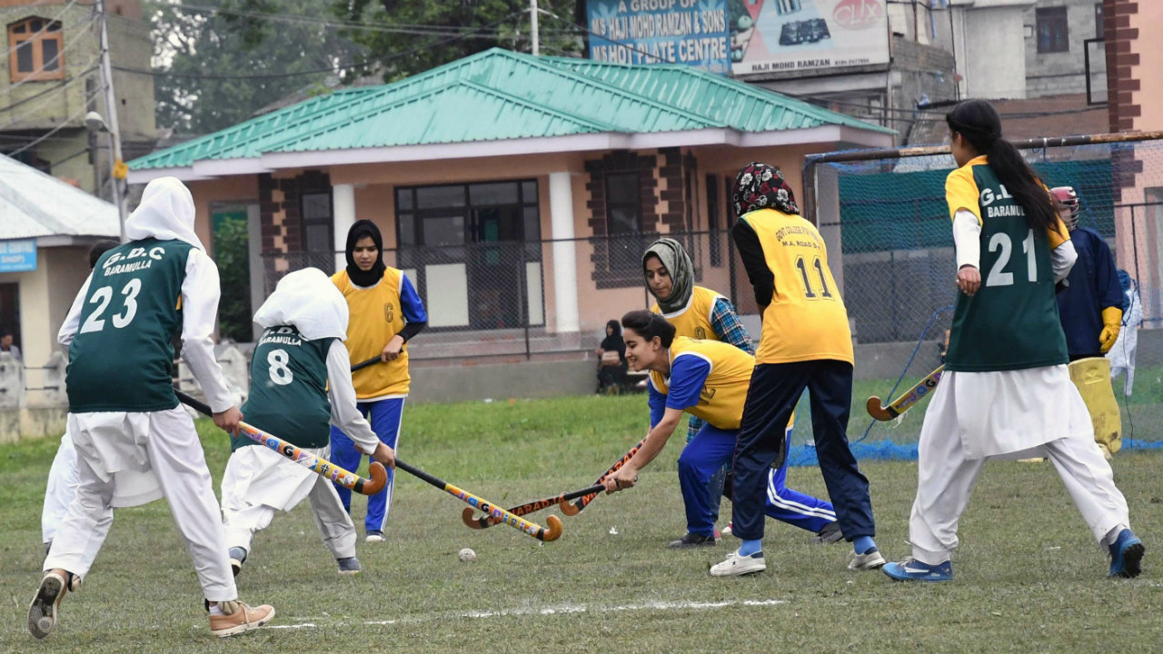 Women players in action during a hockey match between Government Women's College Srinagar and Baramulla Women's Degree College at Women's College Srinagar, Jammu and Kashmir on May 1. (Image: ANI)