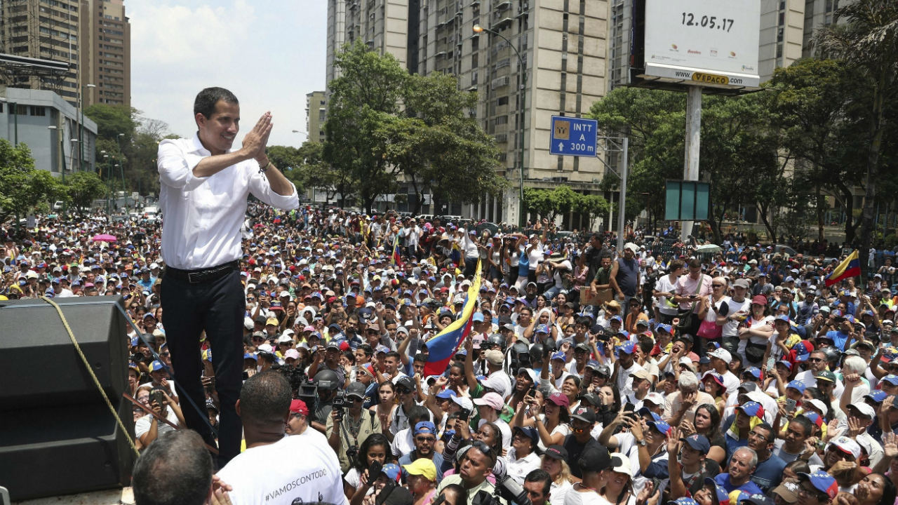 Opposition leader Juan Guaido shows gratitude to supporters during a rally in Caracas, Venezuela. Guaido called for Venezuelans to fill streets around the country on May 1 to demand President Nicolas Maduro's ouster. Maduro also called for his supporters to rally. (Image: AP/PTI)