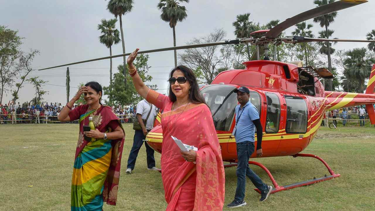 Bollywood actor and BJP Lok Sabha candidate Hema Malini waves at party supporters during an election rally at Kesariya, in East Champaran district. (Image: PTI)