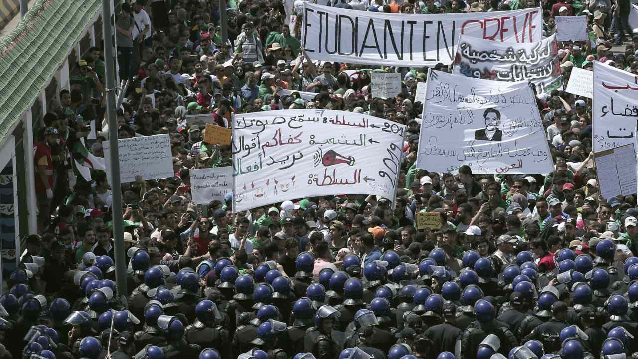 """Algerian students carry a banner reading """"Striking student"""", top, in Algiers. Protests and pressure from the army brought down Algeria's longtime President Abdelaziz Bouteflika but demonstrators want deeper change. (Image: AP)"""