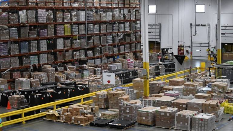 Amazon Rolls Out Box Packing Robots to Replace Workers