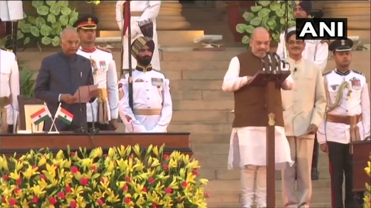 BJP President Amit Shah takes oath for his debut stint as a minister. (Image: ANI)