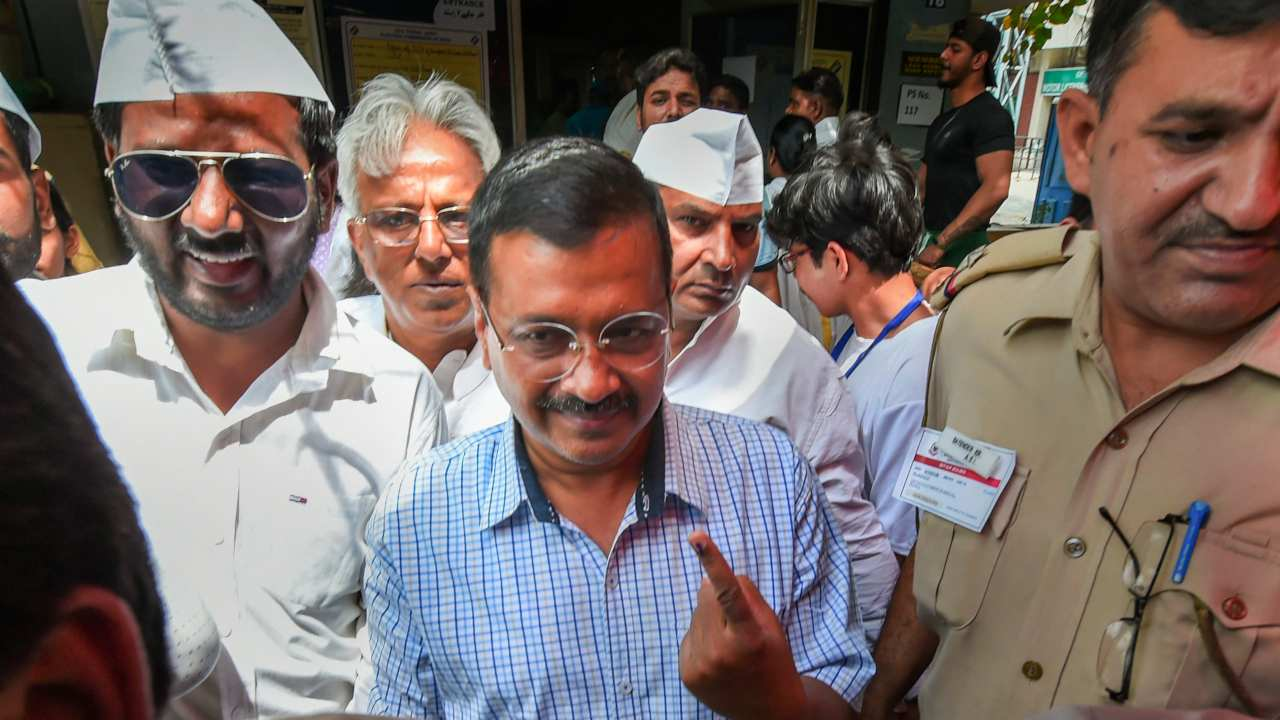 Delhi Chief Minister Arvind Kejriwal shows his inked finger as he leaves after casting vote at a polling station in Delhi. (Image: PTI)