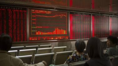 Global Markets: Asia shares shudder as Beijing talks tough
