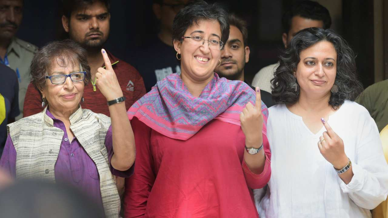 Aam Aadmi Party (AAP)'s East Delhi candidate Atishi, her family members and friends show their finger marked with indelible ink after casting vote in New Delhi. (Image: PTI)