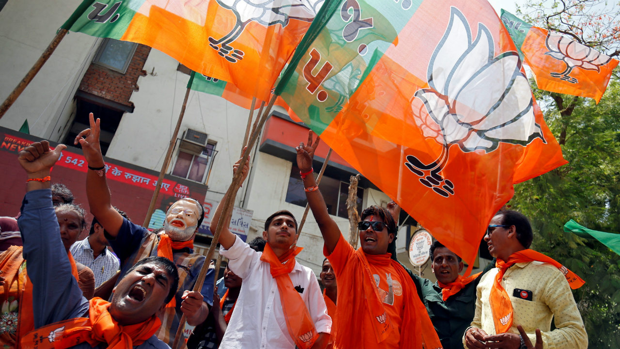 Supporters of Bharatiya Janata Party (BJP) celebrate after learning of initial poll results in Ahmedabad, India. (Image: Reuters)
