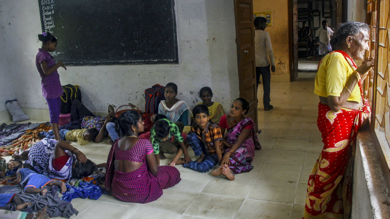 Villagers seen inside a shelter house following evacuations as part of emergency measures taken before Cyclone Fani makes landfall, in Puri, Odisha. (Image: PTI)