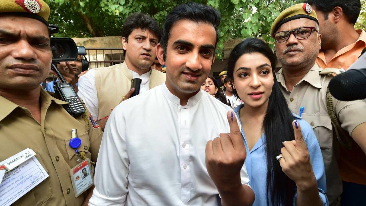 BJP's East Delhi parliamentary candidate Gautam Gambhir and his wife Natasha Jain after casting their vote at Old Rajinder Nagar in New Delhi. (Image: PTI)