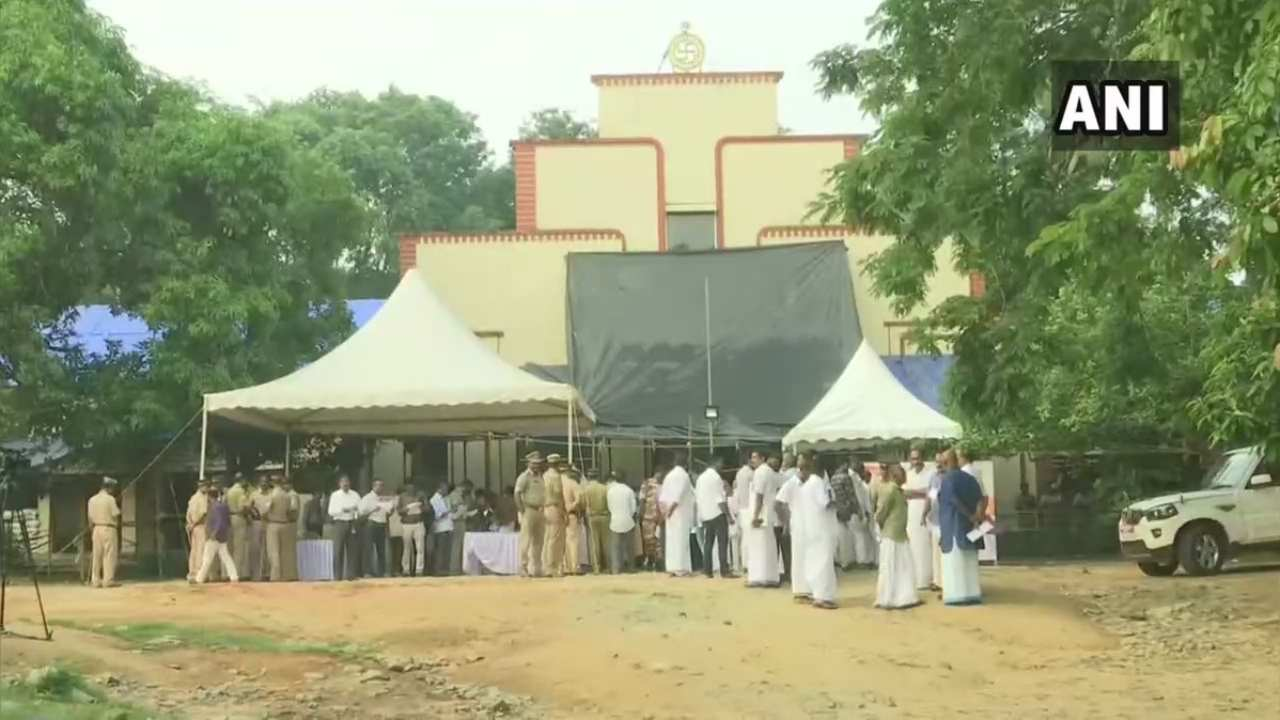 Candidates and counting agents gather outside a polling station in the high-decibel seat of Wayanad in Kerala. Congress President Rahul Gandhi is contesting from this seat. (Image: ANI)