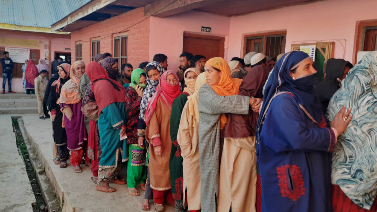 Voters waiting in queue to vote at a polling booth in Shopian, Jammu and Kashmir. The state witnessed three grenade attacks during the fifth phase of polling, including one in Shopian. (Image: PIB India/Twitter)