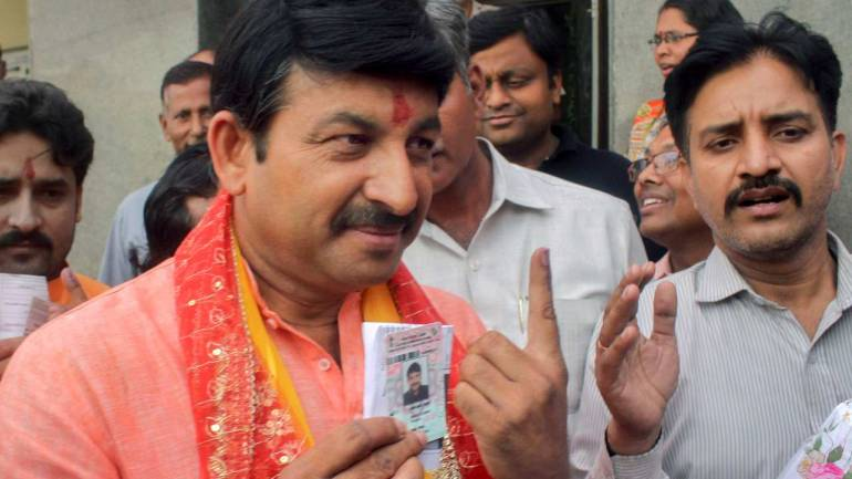 BJP Delhi chief and party candidate from Delhi North East casts his vote in the capital city on May 12. He is contesting against former chief minister and Congress leader Sheila Dikshit; and AAP candidate Dilip Pandey (Image: PTI)