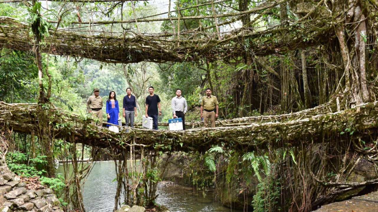 EVM awareness teams traversing towards polling stations across the famous Double Decker Living Root Bridges of Meghalaya at Nongriat polling station under Shillong parliamentary constituency. Meghalaya went to polls on April 11. (Image: Twitter/@SpokespersonECI)