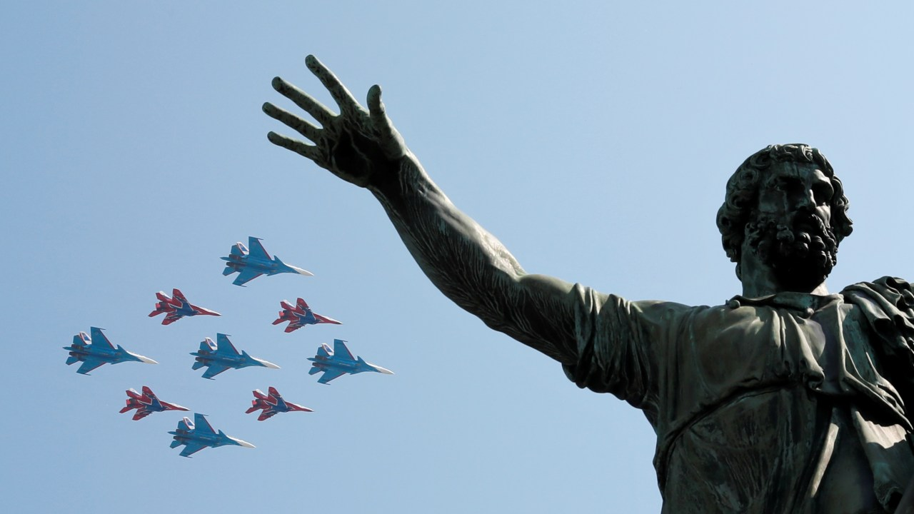 MiG-29 jet fighters of the Strizhi (Swifts) and Su-30 jet fighters of the Russkiye Vityazi (Russian Knights) aerobatic teams fly in formation during a rehearsal for the Victory Day parade, which marks the anniversary of the victory over Nazi Germany in World War Two, above a monument to Kuzma Minin and Dmitry Pozharsky in Red Square in central Moscow, Russia. (Image: Reuters)