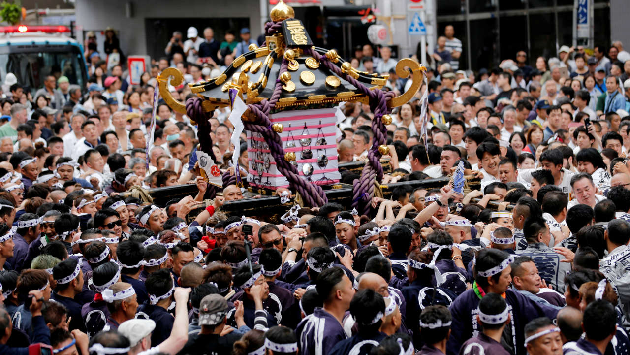 Participants carry Mikoshi, a portable shrine, on the final day of the Sanja Matsuri festival in Asakusa district in Tokyo, Japan. (Image: Reuters)