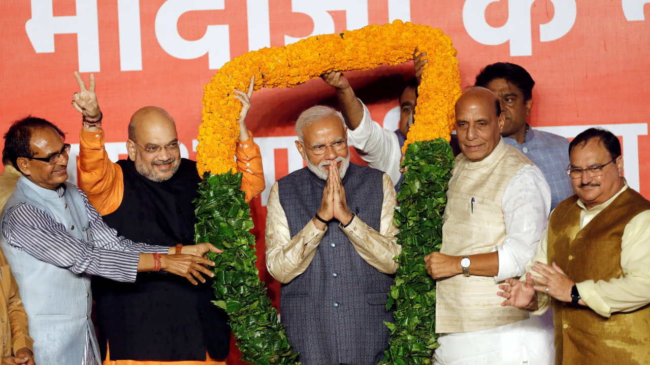 PM Modi being felicitated by senior BJP leaders after the party's historic victory in general elections. (Image: Reuters)