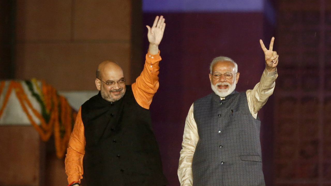 """PM Modi and BJP President Amit Shah gesture at BJP headquarters. """"With great power comes great responsibility,"""" PM Modi said during his victory speech. (Image: Reuters)"""