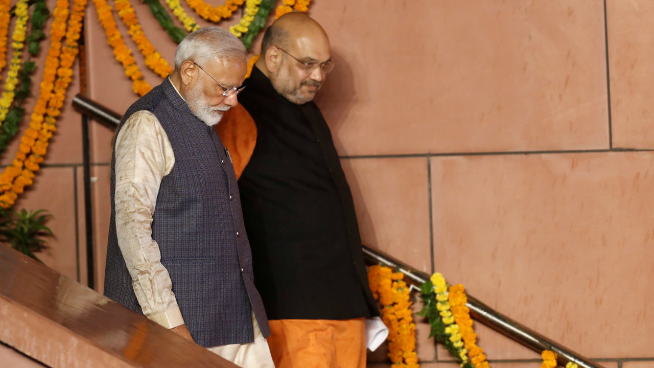 PM Modi and BJP President Amit Shah at the BJP headquarters in New Delhi. The BJP secured a historic mandate, crossing the half-way mark by itself. (Image: Reuters)