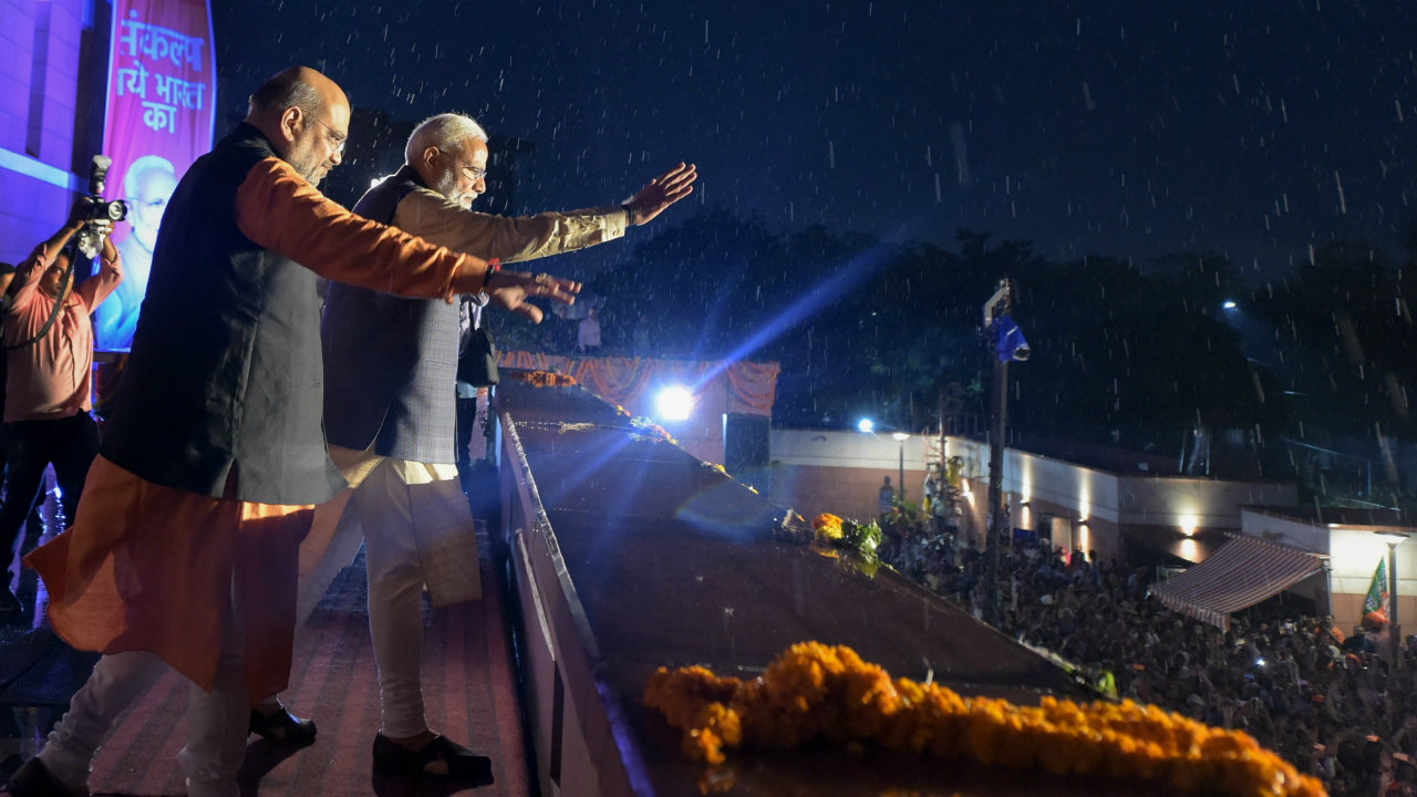PM Modi and BJP President Amit Shah waving to party workers at BJP headquarters in New Delhi. (Image: Reuters)
