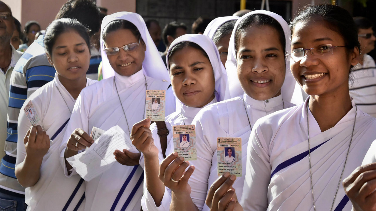 Voters show their ID cards as they wait in a queue to cast vote at a polling station in Ranchi, Jharkhand, during the fifth phase of Lok Sabha elections.  (Image: PTI)