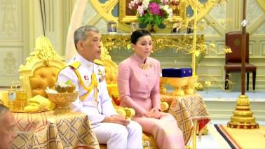 Thailand's new queen: From flight attendant to bodyguard to royalty