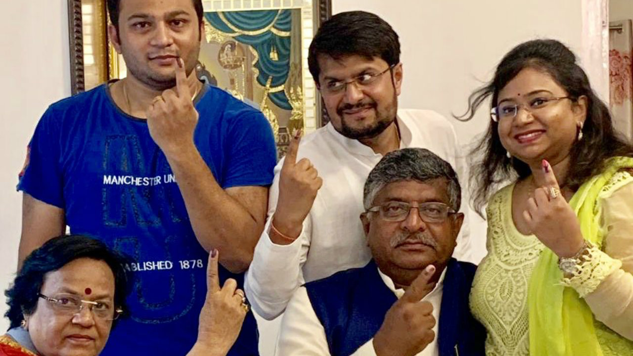 Union Minister and BJP leader Ravi Shankar Prasad with his family after casting their votes. (Image: RS Prasad/Twitter)
